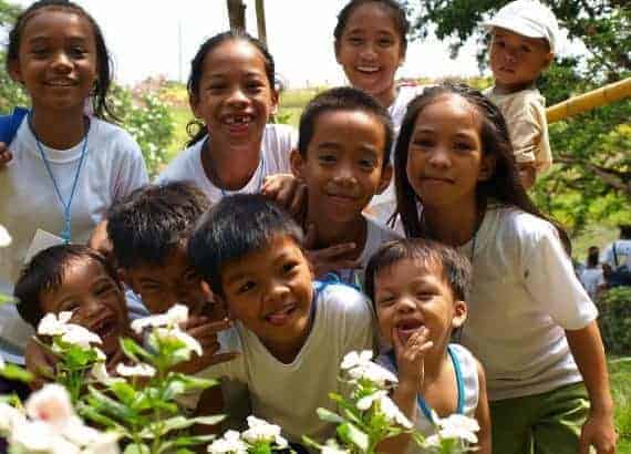 Photo representing smiling children in Asia